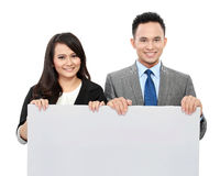 Business team with big blank card Stock Photo