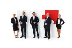 Business team and big puzzle Royalty Free Stock Photos