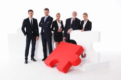 Business team and big puzzle Stock Images
