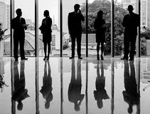 Business team. Black-and-white silhouettes of business people standing and working Royalty Free Stock Photo