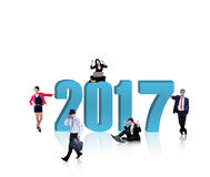 Business team with blue number 2017. Image of busy business people with blue number 2017, isolated on white background. Shot in the studio Stock Image