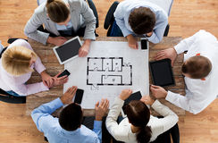 Business team with blueprint and gadgets Royalty Free Stock Photos