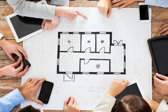 Business team with blueprint and gadgets Royalty Free Stock Images