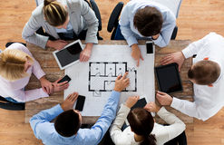 Business team with blueprint and gadgets Stock Photo