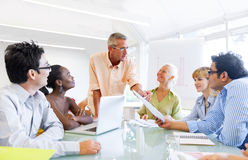 Business Team In Board Room Royalty Free Stock Photo