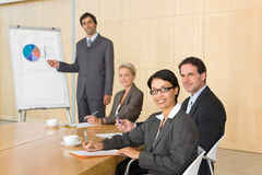 Business team in boardroom. Watching a presentation Stock Photos