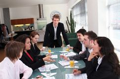 Business Team - The Boss. Image of a young business team in a meeting, image captures discussion of participants stock images