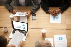 Business team brainstorming analyzing statistics report at meeti royalty free stock photo