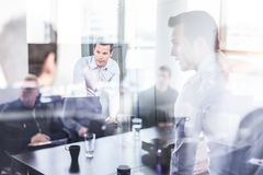 Business team brainstorming on meeting in modern corporate office. stock image