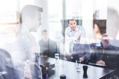 Business team brainstorming on meeting in modern corporate office. royalty free stock image
