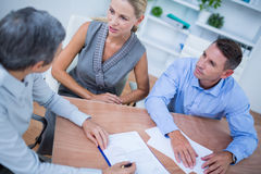 A business team brainstorming together Royalty Free Stock Image