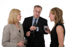 Business Team On Break. Three person business team takes a coffee break royalty free stock photo