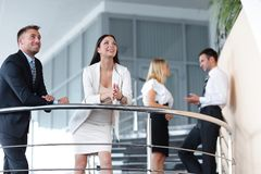 Business team in a break from work, standing on the terrace of the office. Royalty Free Stock Photos