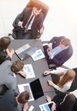 Business team discussing in office financial issues. Business team at a briefing discussing financial charts stock image