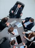 Business team discussing in office financial issues. Business team at a briefing discussing financial charts royalty free stock photo