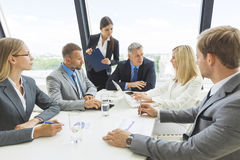 Business team at briefing. Business people team at briefing discuss statistics data diagrams Royalty Free Stock Photos