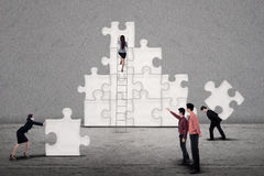 Business team build puzzle together Stock Images