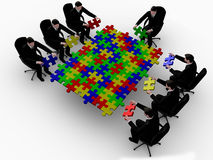 Business team building a color puzzle Stock Photo