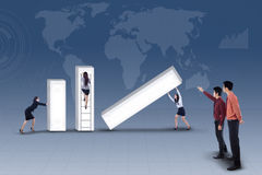 Business team building profit bar chart on blue Stock Image