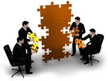 Business team building a puzzle. 3d business team work building a puzzle isolated Stock Photo