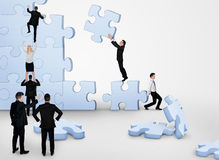 Business team building puzzle. Pieces together Royalty Free Stock Images