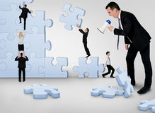 Business team building puzzle Stock Photography