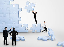 Business team building puzzle. Pieces together Stock Images