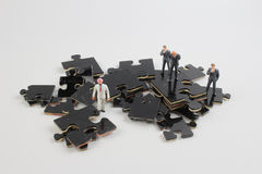 Business team building puzzle pieces together Stock Images