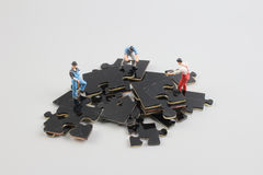 Business team building puzzle pieces together Stock Image