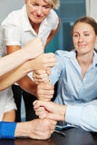 Business team building tower with fists Stock Photos