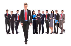 Business team with a business man walking forward. Successful business team with a business men walking forward leading it - be different concept - isolated over royalty free stock images
