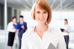 Business team A business team with pretty business Royalty Free Stock Photo