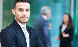 Business team businessman in front of his colleagues Stock Photo