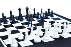 Business team. Businessmen standing on a chessboard Royalty Free Stock Image