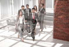 Business team, businesspeople group walking at modern bright office interior stock image