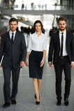 Business Team. Businesspeople walking in the corridor.  stock image