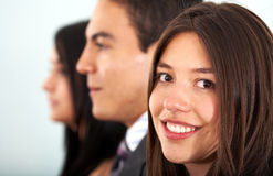 Business team with a businesswoman leading Stock Photo