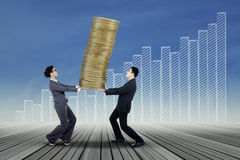 Business team carrying gold coins Royalty Free Stock Images