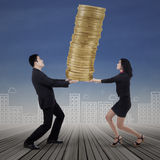 Business team carrying gold coins Royalty Free Stock Photos