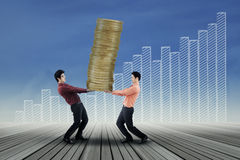Business team carrying golden coins Stock Images