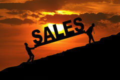 Business team carrying sales word Royalty Free Stock Photography
