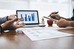 Business team casual collaboration discussing working analysis with financial data and marketing growth report graph in team, royalty free stock image