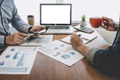 Business team casual collaboration discussing working analysis with financial data and marketing growth report graph in team, royalty free stock images