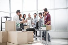 Business team celebrates the move while standing in the office stock image