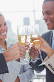 Business team celebrating with champagne and clinking glasses Stock Photos