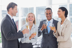 Business team celebrating with champagne Royalty Free Stock Photography