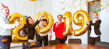 Business team celebrating New Year stock images