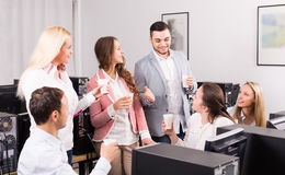 Business team celebrating project close-out Stock Image