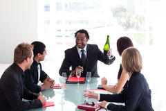 Business team celebrating a success with champagne Stock Images