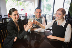 Business team celebrating a success with champagne in restaurant Stock Photos